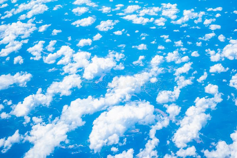 Aerial view of white cloud and blue sky. Aerial view of beautiful nature with white cloud and blue sky royalty free stock photo