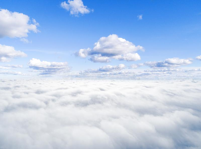 Aerial view White clouds in blue sky. Top view. View from drone. Aerial bird`s eye view. Aerial top view cloudscape. Texture of c. Louds. View from above royalty free stock photos