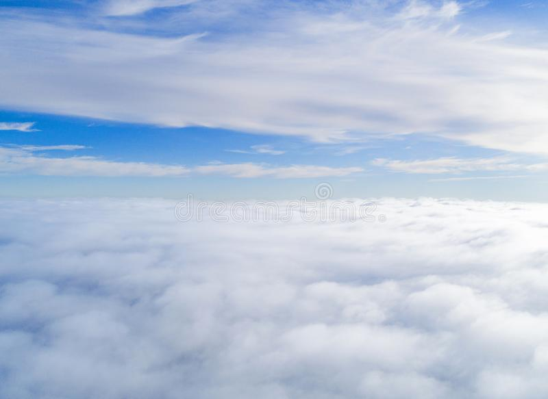 Aerial view White clouds in blue sky. Top view. View from drone. Aerial bird`s eye view. Aerial top view cloudscape. Texture of c. Louds. View from above royalty free stock images