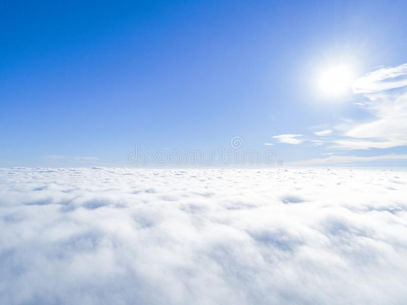 Aerial view White clouds in blue sky. Top view. View from drone. Aerial bird`s eye view. Aerial top view cloudscape. Texture of cl. Ouds. View from above stock images