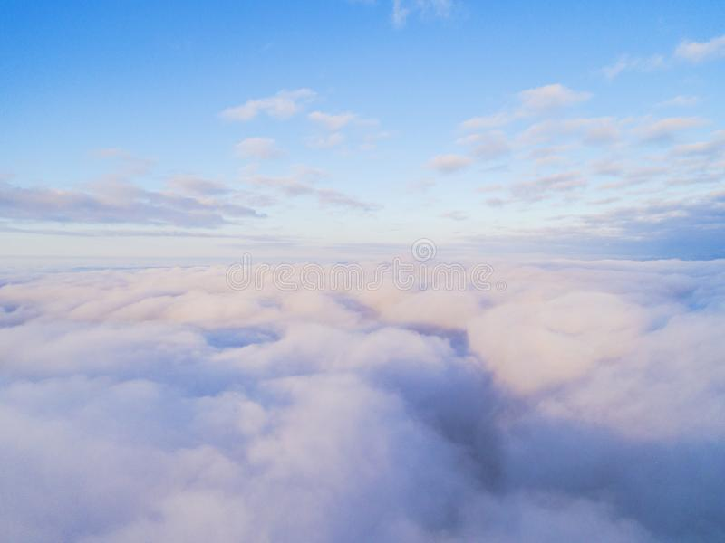 Aerial view White clouds in blue sky. Top view. View from drone. Aerial bird`s eye view. Aerial top view cloudscape. Texture of cl. Ouds. View from above royalty free stock photography
