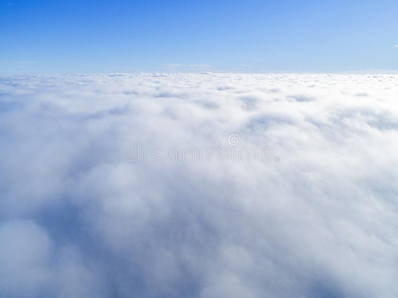 Aerial view White clouds in blue sky. Top view. View from drone. Aerial bird`s eye view. Aerial top view cloudscape. Texture of cl. Ouds. View from above stock image