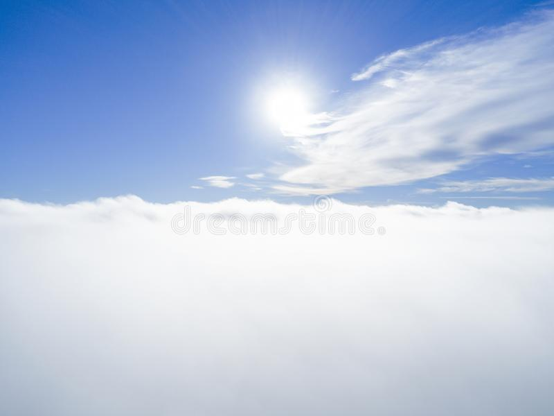 Aerial view White clouds in blue sky. Top view. View from drone. Aerial bird`s eye view. Aerial top view cloudscape. Texture of cl. Ouds. View from above royalty free stock photo