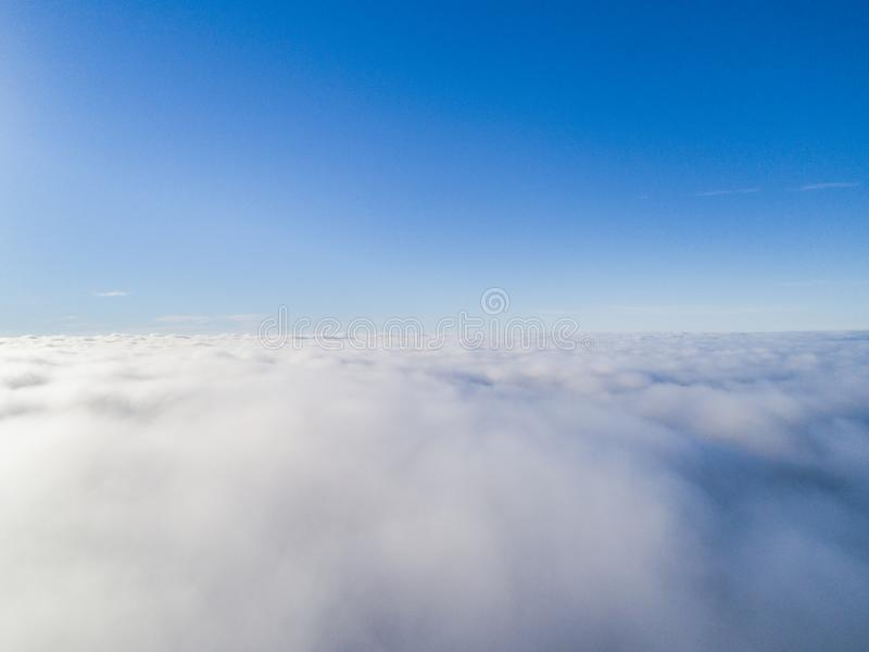Aerial view White clouds in blue sky. Top view. View from drone. Aerial bird`s eye view. Aerial top view cloudscape. Texture of cl. Ouds. View from above stock photography