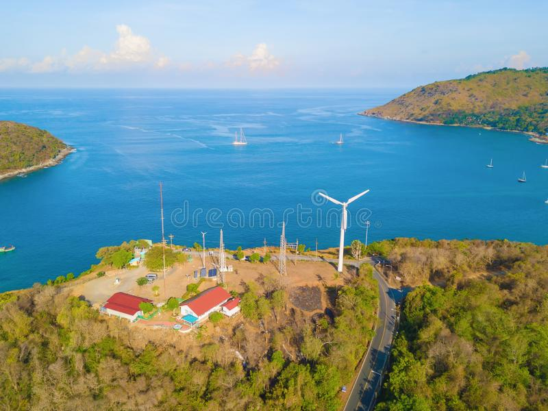Aerial view of a wind turbine at Patong beach with blue turquoise seawater, and tropical green forest trees with Andaman sea in. Phuket island in summer royalty free stock photo