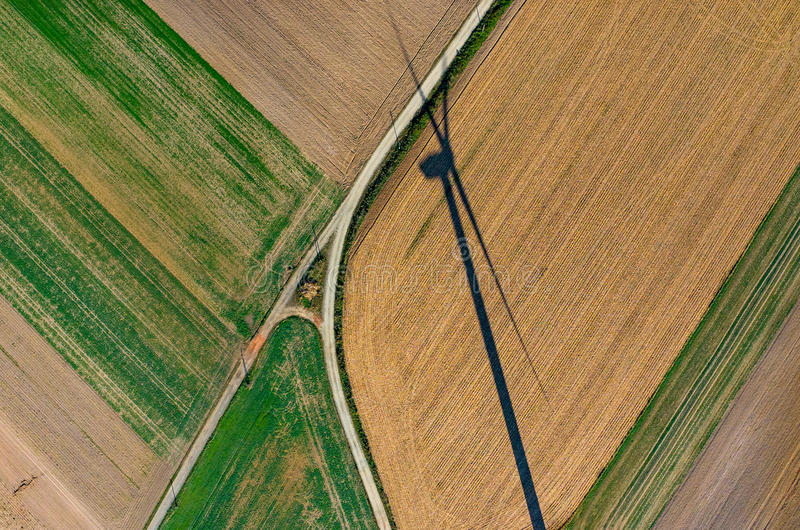 Aerial view on the windmill's shadow royalty free stock image