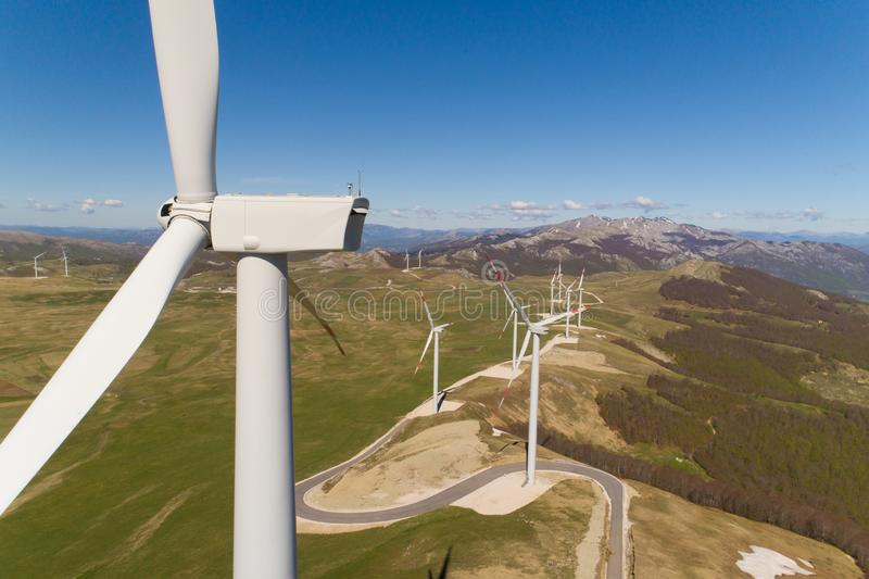 Aerial view on the windmills on the hills royalty free stock images