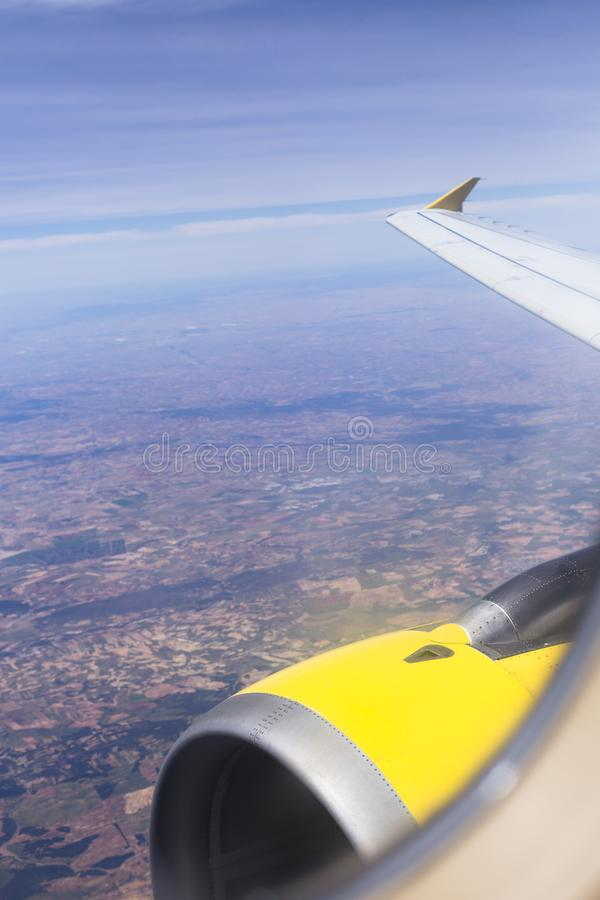 Aerial view from a window plane during flight. Brown landscape above in Spain. Travel concept. Farm, scenic, crops, world, organic, terrain, textured royalty free stock photos