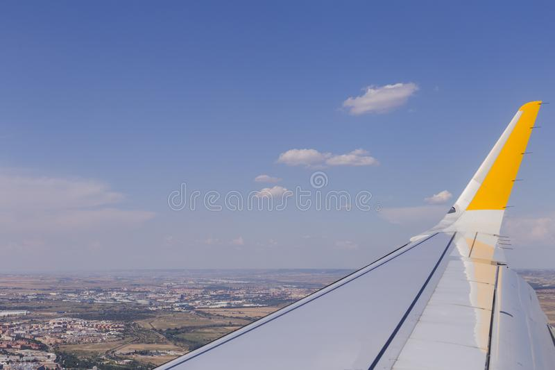 Aerial view from a window plane during flight. Brown landscape above in Spain. Travel concept. Farm, scenic, crops, world, organic, terrain, textured royalty free stock images