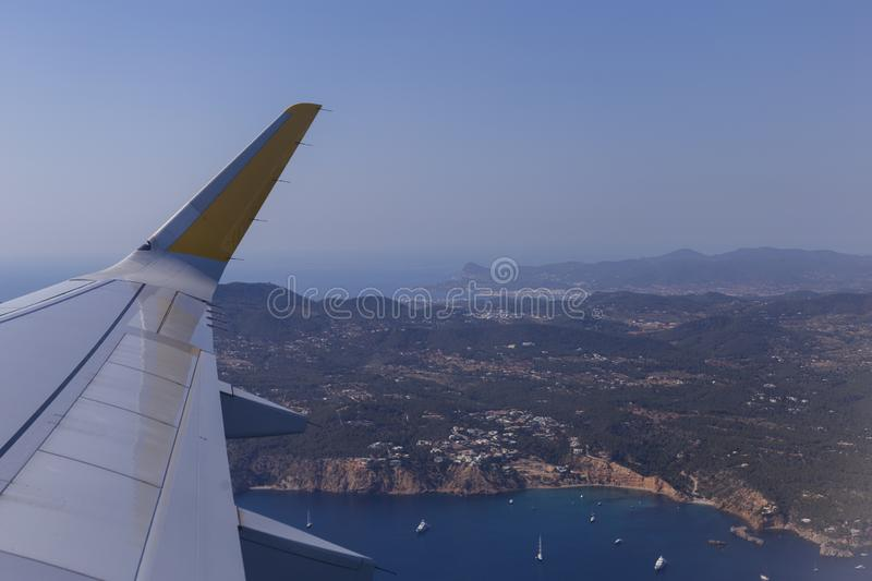 Aerial view from a window plane during flight. Ibiza landscape above in Spain. Travel concept. Scenic, world, panoramic, food, supply, farm, field, altitude royalty free stock image