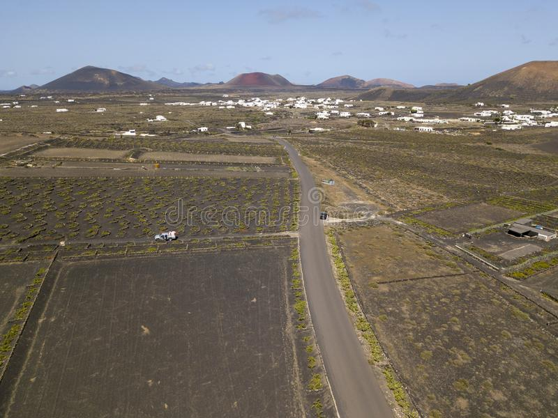 Aerial view of the wine cultivations on the volcanic soils of the island of Lanzarote. Canary Islands, Spain. Wine production. Aerial view of the wine stock image