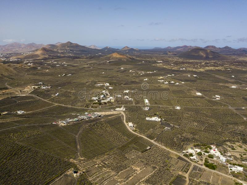 Aerial view of the wine cultivations on the volcanic soils of the island of Lanzarote. Canary Islands, Spain. Wine production. Aerial view of the wine royalty free stock photography
