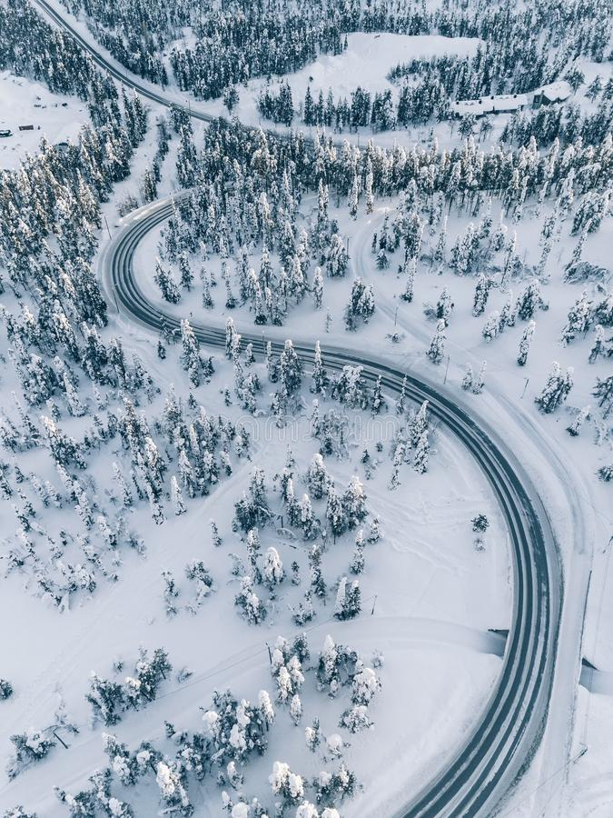 Aerial view winter of road in the forest covered with snow, Finland Lapland royalty free stock photo