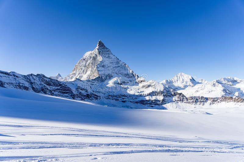 Stunning view of winter Matterhorn mountain landscape in sunny bright day stock photography