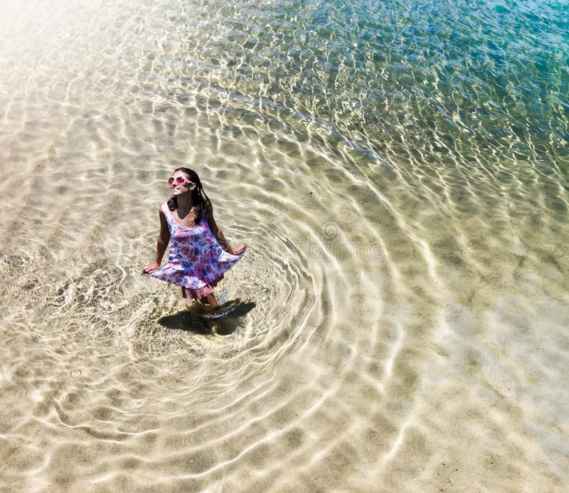 Aerial view of a woman in the sea stock photo