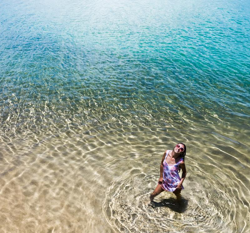 Aerial view of a woman in the sea royalty free stock images