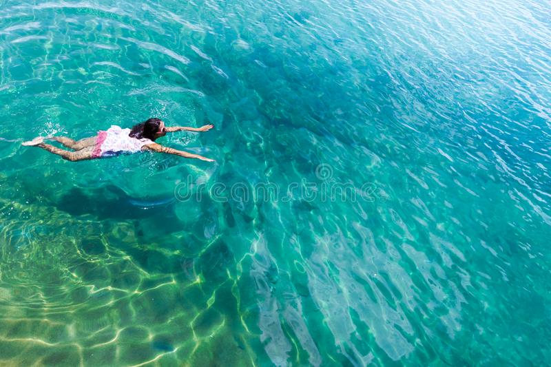 Aerial view of a woman in the sea stock image