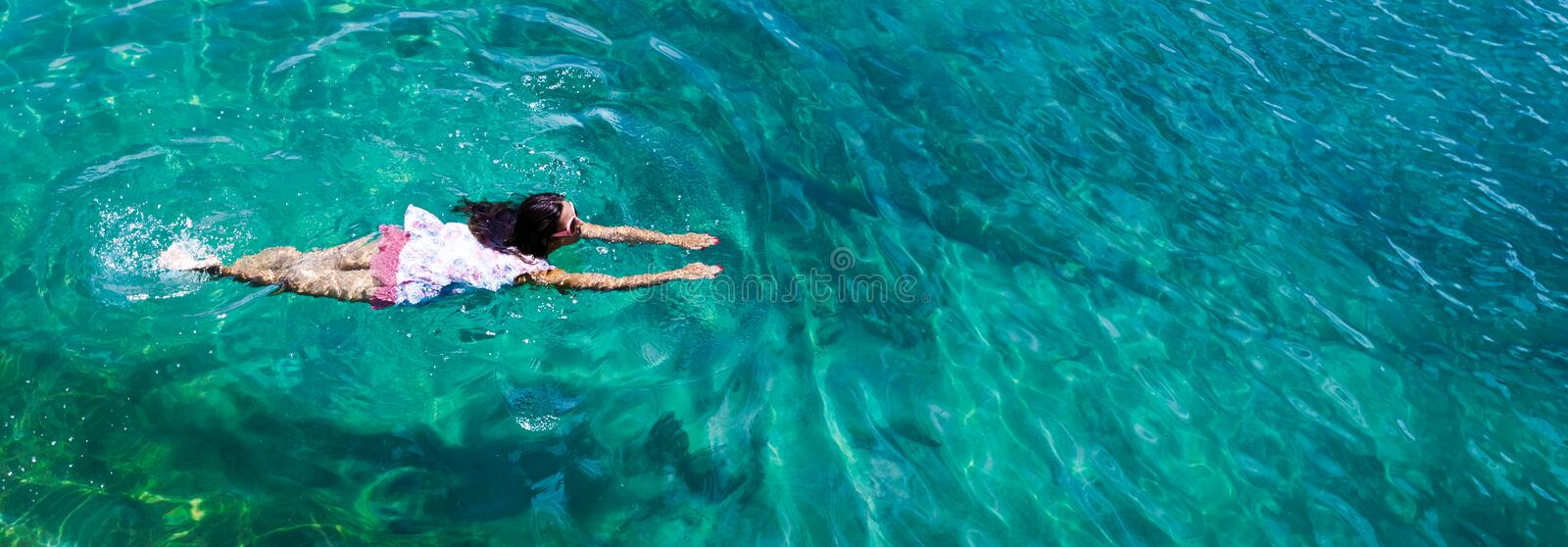 Aerial view of a woman in the sea royalty free stock image