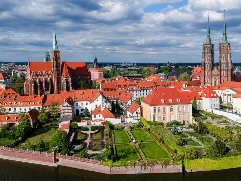 The aerial view of Wroclaw: Ostrow Tumski, Cathedral of St. John the Baptist and Collegiate Church of the Holy Cross and St. Barth royalty free stock image