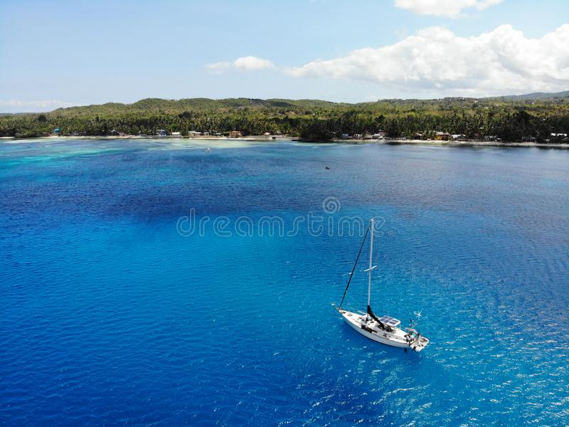 Aerial View of Yacht in front of Siquijor Island, The Philippines royalty free stock photography