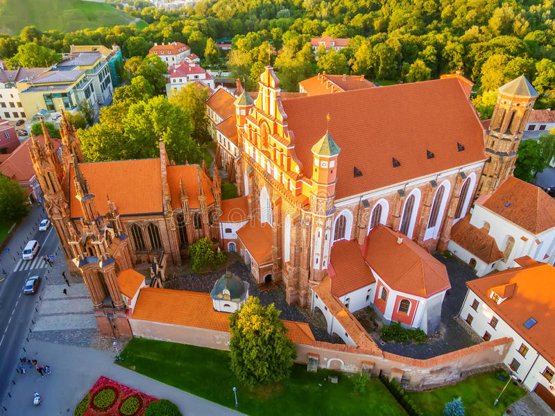 AERIAL. Vilnius, Lithuania: St Anne's and Bernadines Churches. AERIAL TOP VIEW. Old Town in Vilnius, Lithuania: St Anne's and Bernadine's Churches, Lithuanian stock photo