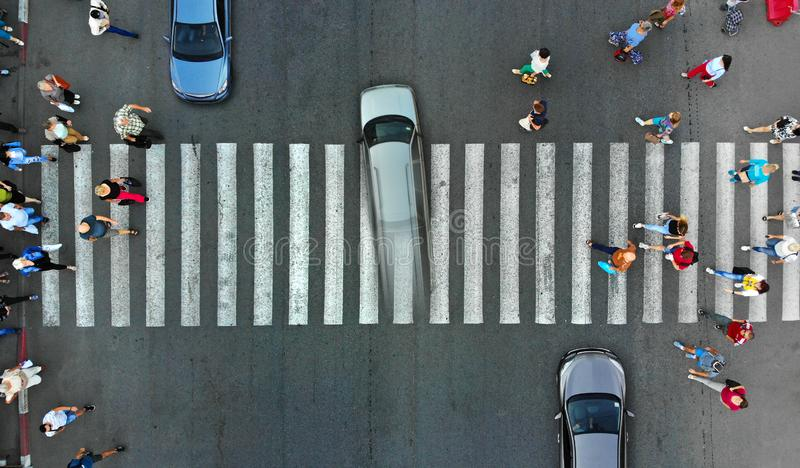 Aerial. Violation of traffic rules. The car passes on a high speed red light through a pedestrian crossing. Aerial. Violation of traffic rules. The car passes royalty free stock image