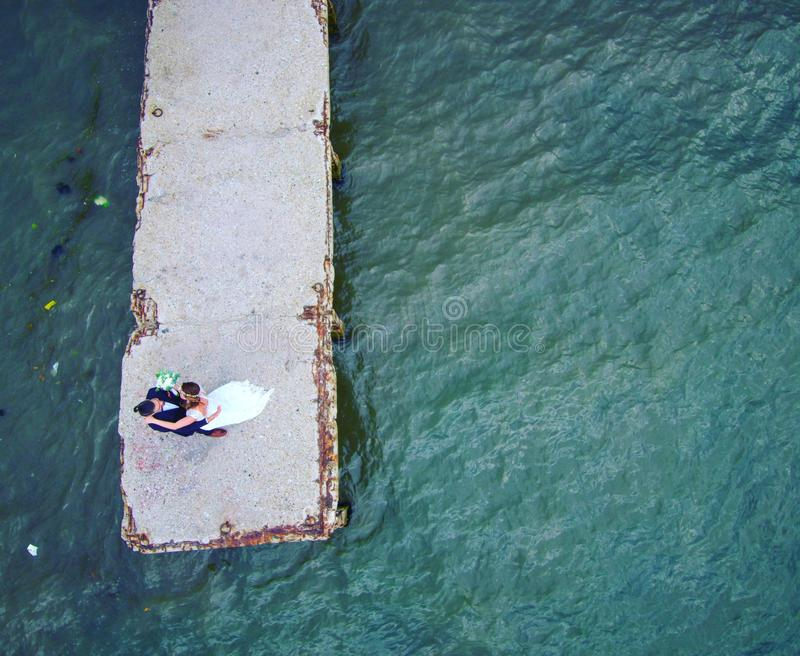Aerial wedding photography on pier in area of Thessaloniki Greece royalty free stock images