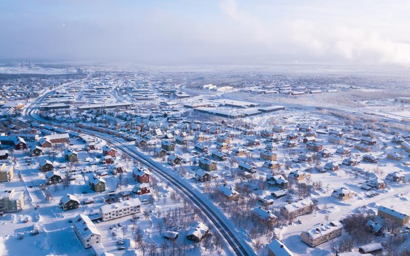 Aerial winter view of Kiruna, the northernmost town in Sweden, province of Lapland, winter sunny picture shot from drone. Aerial winter view of Kiruna, the stock photo