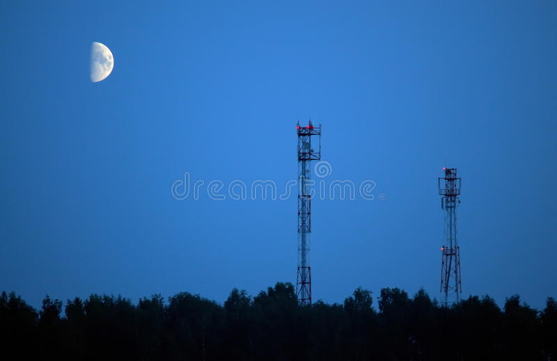 Aerials of cellular communication and moon royalty free stock images