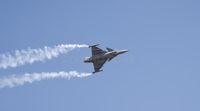 Aero India Show. Fighter jet doing aerobatic manoeuvres during the recently concluded Aero show in India royalty free stock photos