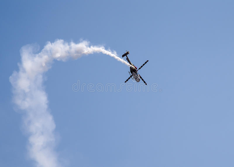 Aero India Show. Helicopter doing aerobatic manoeuvres during the recently concluded Aero show in India royalty free stock photos