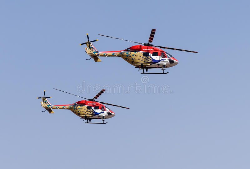 Aero India Show. Helicopters doing aerobatic manoeuvres during the recently concluded Aero show in India stock photography