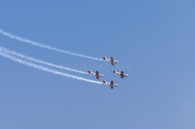 Aero India Show. Planes doing aerobatic manoeuvres during the recently concluded Aero show in India royalty free stock photo