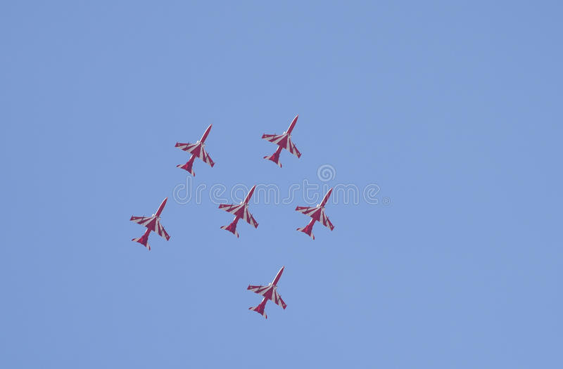 Aero India Show. Planes flying in a synchronised formation during the recently concluded Aero show in India royalty free stock photo