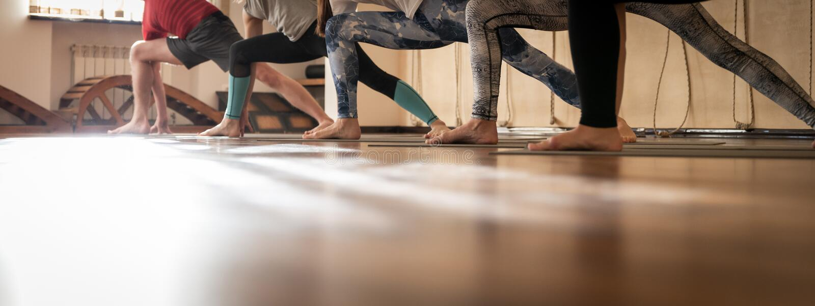 Aerobic Pilates in a gym, group class in a row stock images