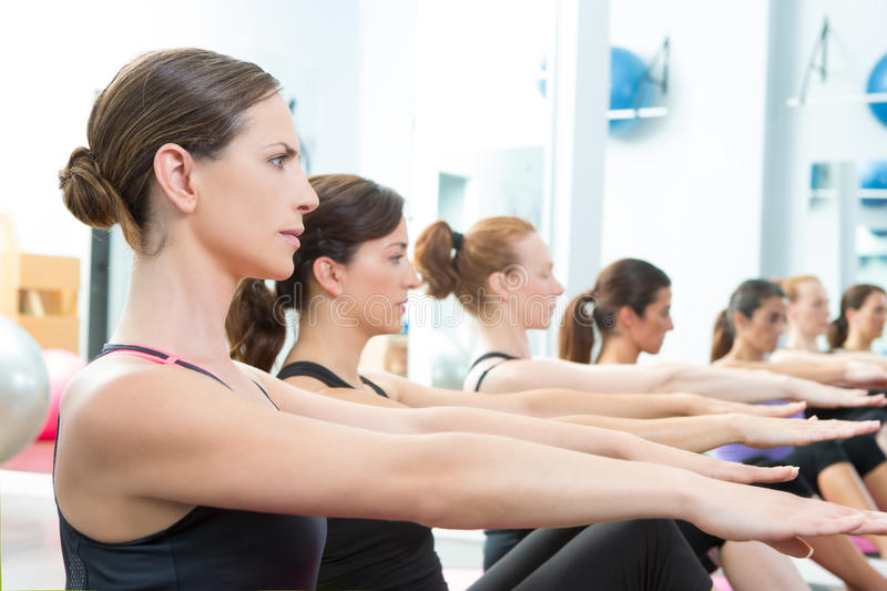 Aerobic Pilates personal trainer group class royalty free stock image