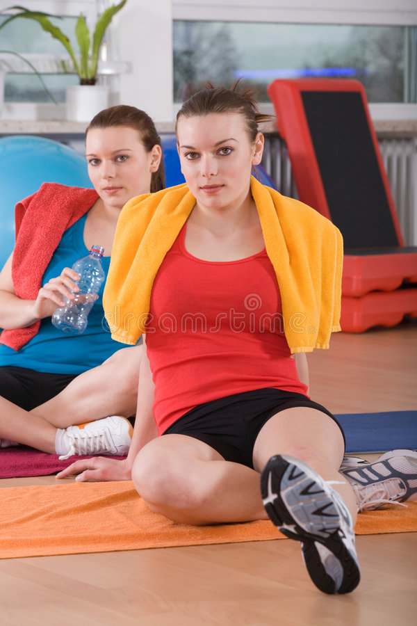 Aerobics 1. Young women exercising in a step aerobics class royalty free stock image