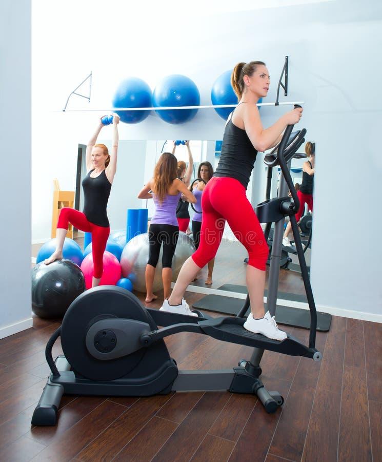 Aerobics cardio training woman on elliptic