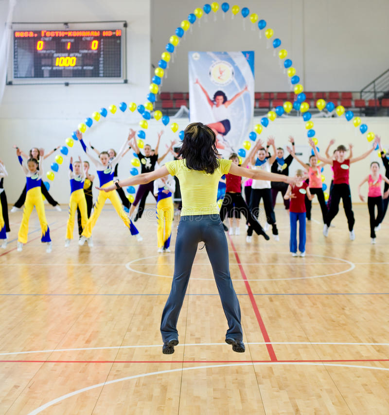 Aerobics and fitness. ULAN-UDE, RUSSIA - MAY 2: The Festival of aerobics and fitness. Representatives of teams repeat movements after a trainer at her master royalty free stock photos