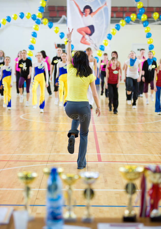 Aerobics and fitness. ULAN-UDE, RUSSIA - MAY 2: The Festival of aerobics and fitness. Representatives of teams repeat movements after a trainer at her master royalty free stock photo