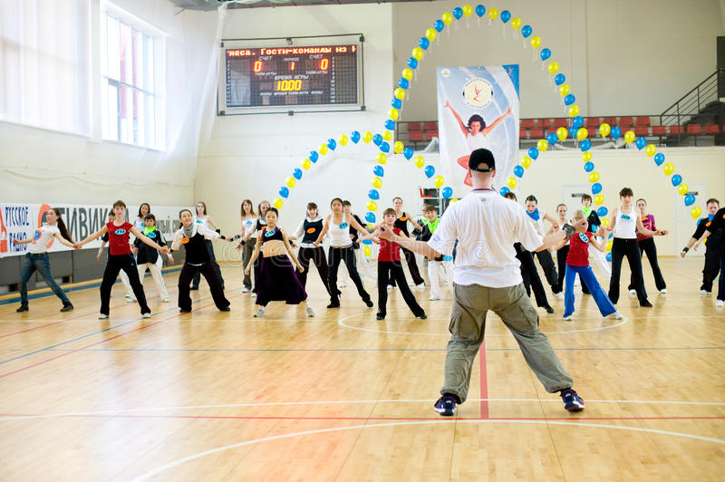 Aerobics and fitness. ULAN-UDE, RUSSIA - MAY 2: The Festival of aerobics and fitness. Representatives of teams repeat movements after a trainer at his master stock photos