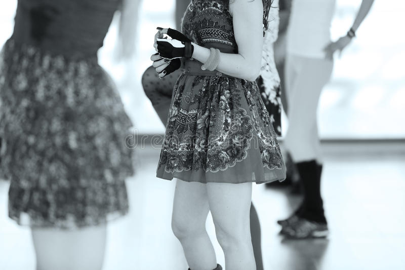 Aerobics girl dancing. Girls in skirts and leggings dancing in an aerobics class royalty free stock photography