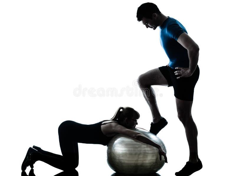 Aerobics intstructor with mature woman exercising stock photos