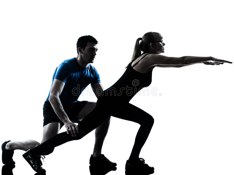 Aerobics intstructor with mature woman exercising royalty free stock images