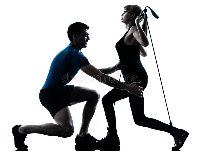 Aerobics intstructor with mature woman exercising royalty free stock image