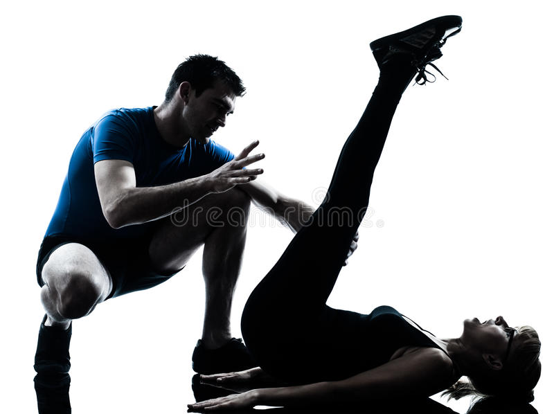 Aerobics intstructor with mature woman exercising silhouette royalty free stock images