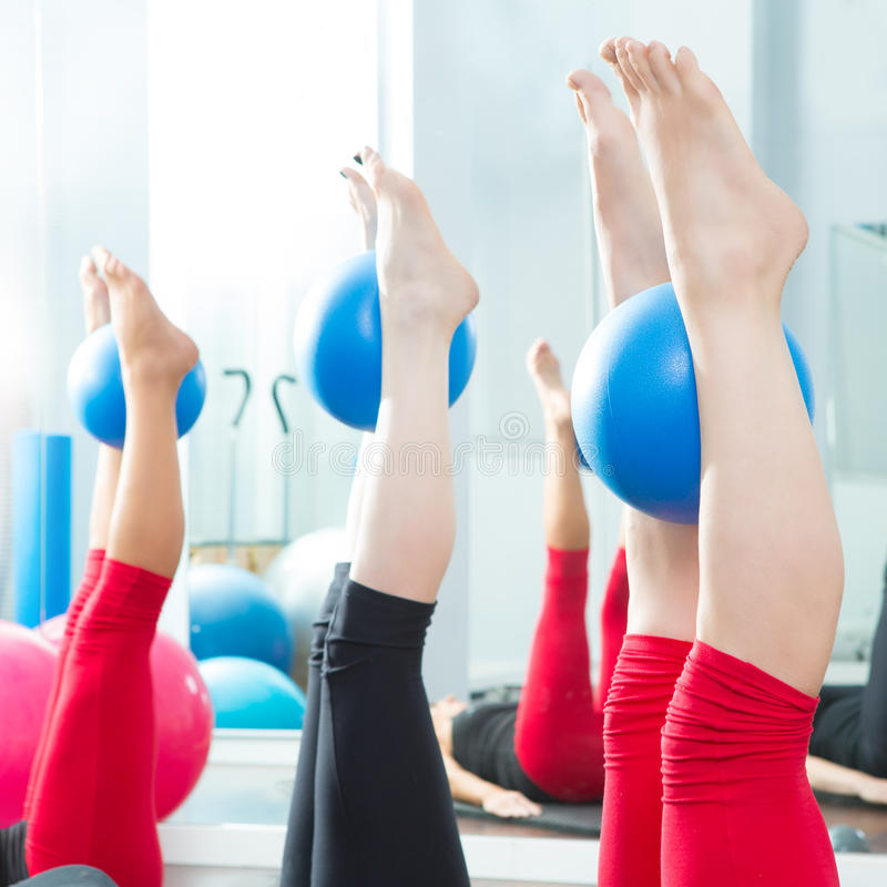Aerobics pilates women feet with yoga balls royalty free stock photo