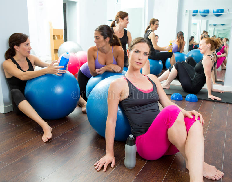 Aerobics pilates women group having a rest at gym. Talking and having fun royalty free stock photography