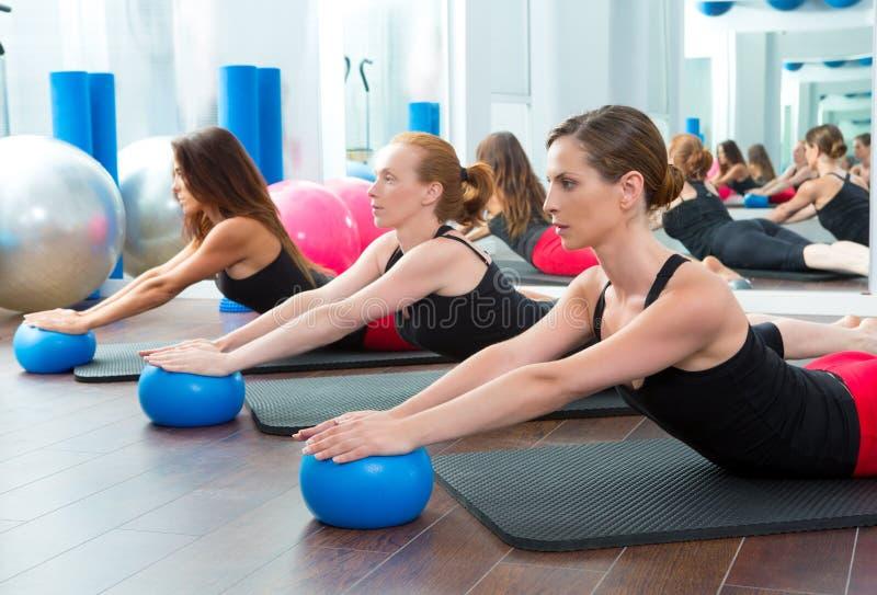 Aerobics pilates women with yoga balls stock images
