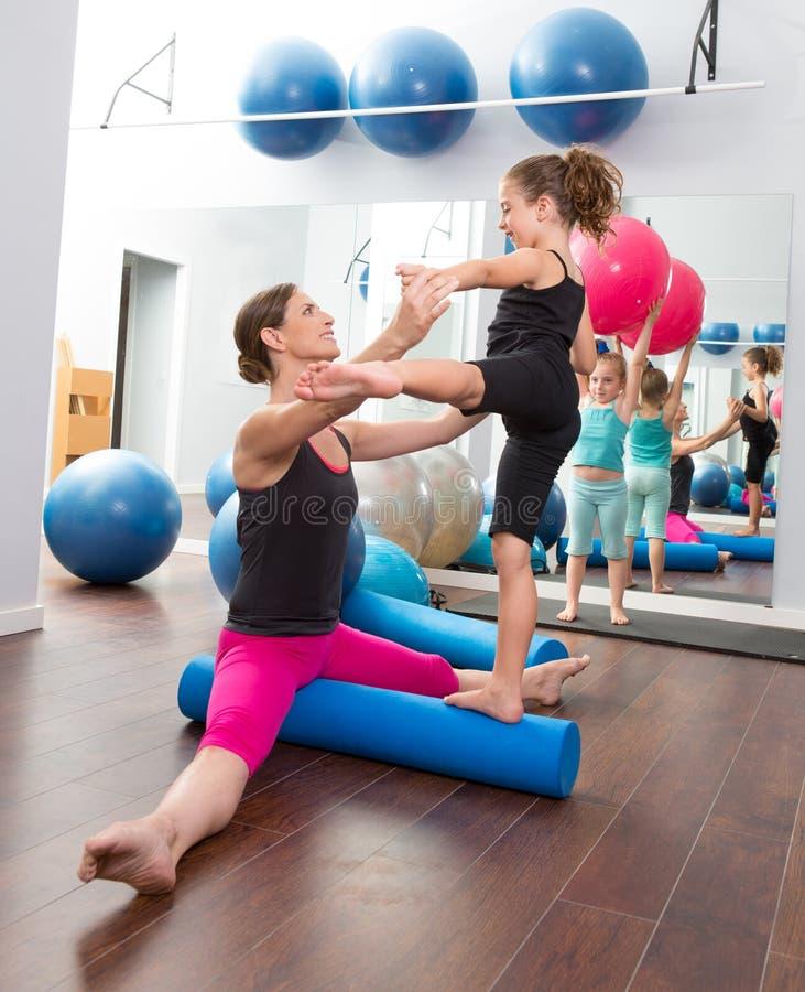 Aerobics woman personal trainer of children girl stock photos